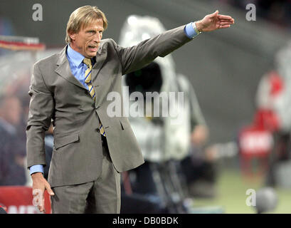 Cologne's head coach Christoph Daum gives directions from the sidelines during the soccer friendly 1st FC Cologne - Stock Photo