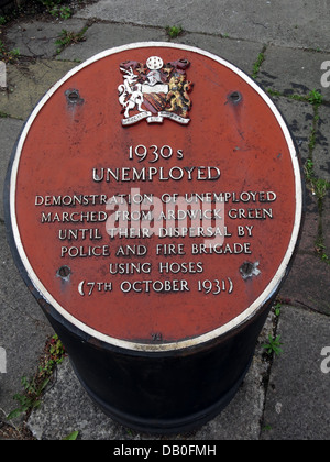 Red plaque commemorating 1930s unemployed in Ardwick Manchester . Demonstration of unemployed marched from Ardwick - Stock Photo