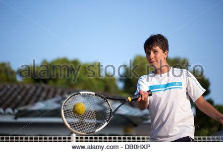 boy playing tennis - Stock Photo