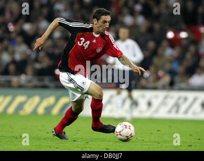 (dpa file) - Germany's Roberto Hilbert controls the ball during the international match England vs Germany at Wembley - Stock Photo