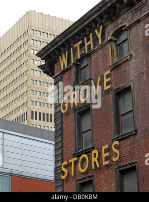 The old withy Grove Stores victorian building in Shudehill Manchester City Centre with the 1970s Arndale shopping - Stock Photo