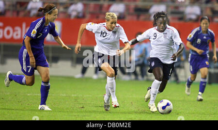 Japan's Tomomi Miyamoto (L) and England's Kelly Smith and Eniola Aluko (R) vie for the ball during the Women's World - Stock Photo