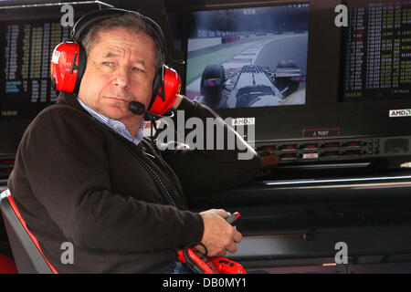 French Jean Todt, CEO of Scuderia Ferrari, observes his mechanics from the control stand during the second practice - Stock Photo