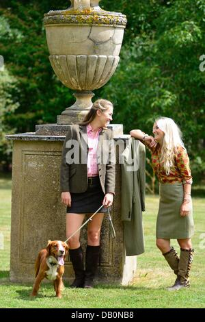 Alcester, Warwickshire. 21st July, 2013. Really Wild Clothing's Nathalie Clough and Marina Gibson with cocker spaniel - Stock Photo