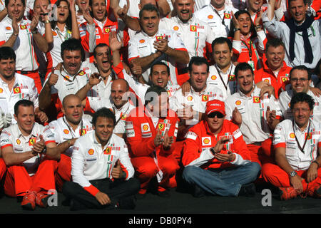 Scuderia Ferrari CEO French Jean Todt (C) celebrates with  third placed Brazilian Formula One driver Felipe Massa - Stock Photo