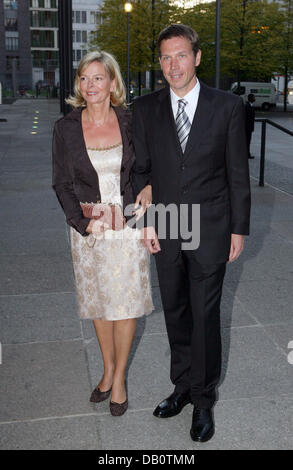 Deutsche Telekom CEO Rene Obermann (R) and his wife (L) arrive for the international gala evening introducing the - Stock Photo