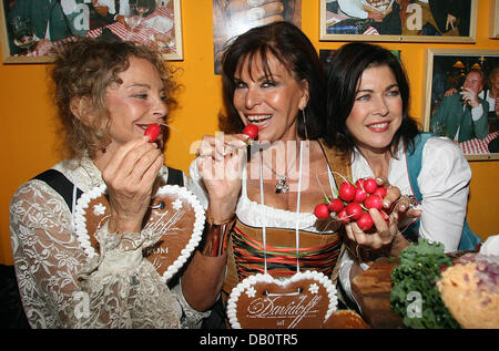 Actress Sydne Rome (L-R), astrologist Elisabeth Tessier and actress Anja Kruse show their gingerbread hearts at - Stock Photo