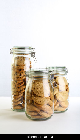 Chocolate, lavender and hazelnut cookies in a jar on white background - Stock Photo