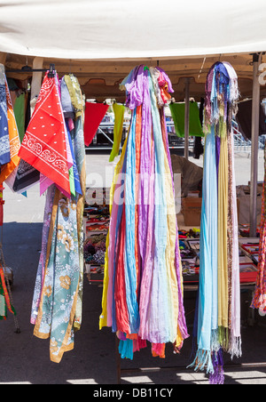 Brightly coloured scarves and pashminas on sale in a market stall in Lecce, Apulia, southern Italy - Stock Photo