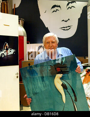 Photographer, documentary filmer and art collector Gunter Sachs poses with some of his photographies and paintings - Stock Photo