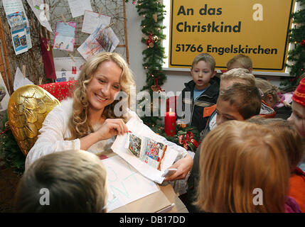 A model dressed up as the 'Christkind' (Christ Child) accepts children's Christmas wishes in Engelskirchen, Germany, - Stock Photo