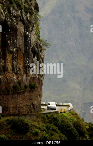 (dpa-file) - A car rides along mountain roads towards parish Curral das Freiras on Madeira, Portugal, 2006. Photo: - Stock Photo