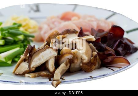Food Ingredients including with Sliced Mushrooms, Sliced Pork and Leek. - Stock Photo