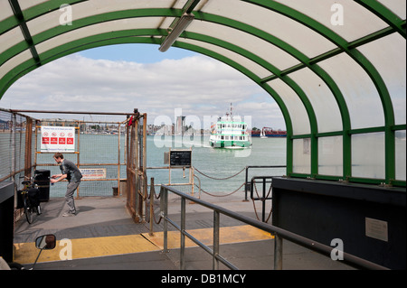 The landing stage at Portsmouth Harbour, with the Gosport Ferry arriving, Portsmouth, UK - Stock Photo