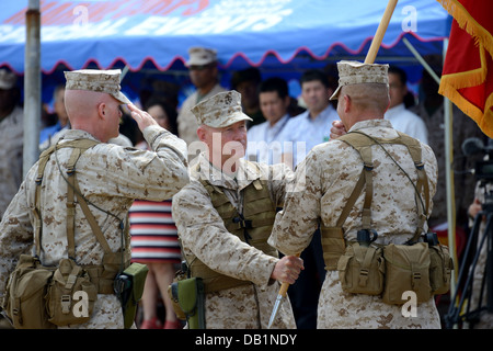Lt. Gen. Kenneth J. Glueck Jr., center, passes the III Marine Expeditionary Force organizational colors to Lt. Gen. - Stock Photo