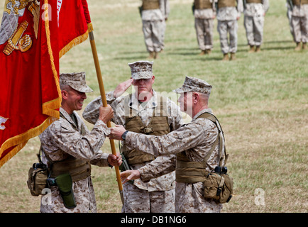 Lt. Gen. Kenneth J. Glueck Jr., right, passes the III Marine Expeditionary Force organizational colors to Lt. Gen. - Stock Photo