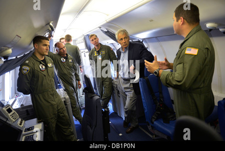 Secretary of Defense Chuck Hagel, second from right, tours the interior of a U.S. Navy P-8 Poseidon aircraft assigned to Patrol