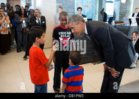 US President Barack Obama talks with young children before departing the Radisson Blu Hotel during his visit June - Stock Photo