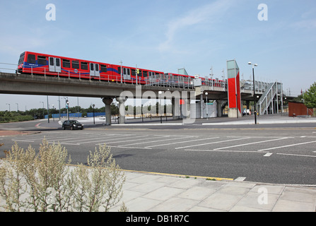 A London Docklands Light Railway train departs from Gallions Reach station in Beckton, east London, UK - Stock Photo
