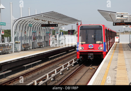 A London Docklands Light Railway train arrives at Gallions Reach station in Beckton, east London, UK - Stock Photo