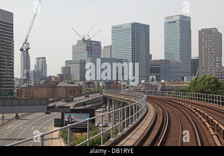 Road and rail links to London's Canary Wharf business district - Stock Photo