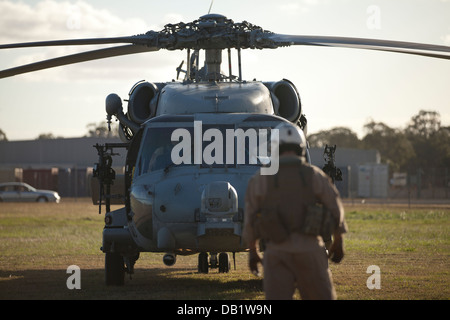 A U.S. Navy HH-60H Sea Hawk assigned to the Firehawks of Helicopter Sea Combat Support Squadron (HSC) 85 prepares - Stock Photo