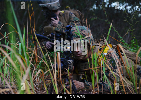 Two U.S. Marines with Golf Company, Battalion Landing Team 2nd Battalion, 4th Marines, 31st Marine Expeditionary Unit, perform a