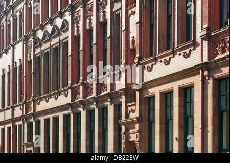 An abstract view of a classic architecture red brick building in Manchester city centre on Lloyd Street. - Stock Photo