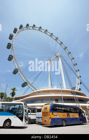 City tour bus, ferris wheel in background, Waterfront ...