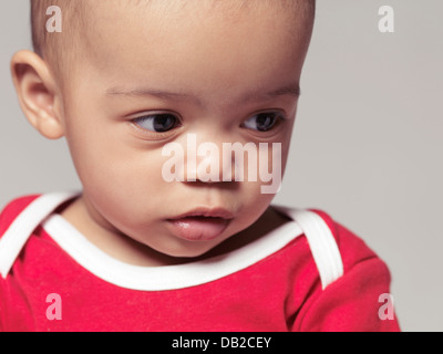 Closeup portrait of a cute little black baby girl. Nine months old child. - Stock Photo