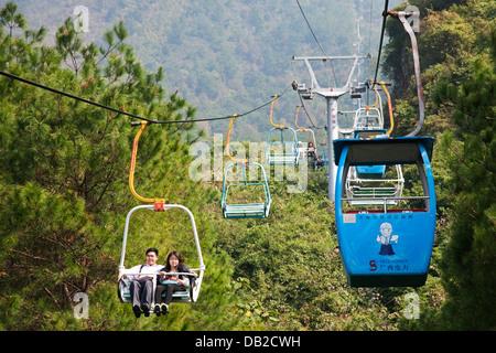 Chairlift leading to the top of Yaoshan Mountain. Guangxi Zhuang Autonomous Region, China - Stock Photo