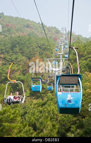 Chairlift leading to the top of Yaoshan Mountain. Guangxi Zhuang Autonomous Region, China - Stock Photo