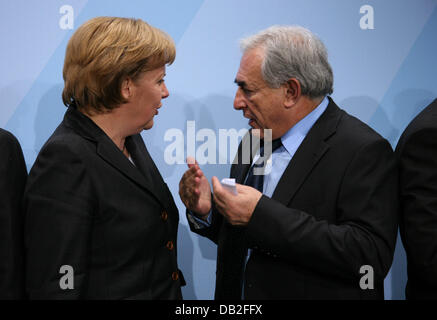 German Chancellor Angela Merkel (L) and the Managing Director of the International Monetary Fund (IMF) Dominique - Stock Photo