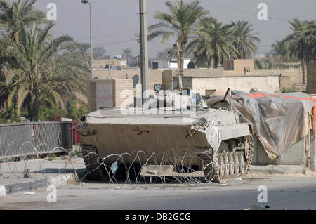 An Russian BMP-1 infantry fighting vehicle (IFV) of the Iraqi  guards a check point in Bagdad, Iraq, March 2007. - Stock Photo