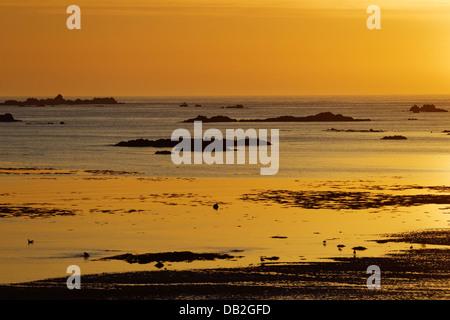 Sunset across L'Eree Bay Channel Islands, UK LA005914 - Stock Photo
