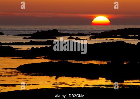 Sunset across L'Eree Bay Channel Islands, UK LA005920 - Stock Photo