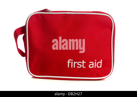 Small red First Aid kit on a white background - Stock Photo