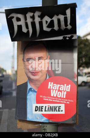 A folded election poster by the APPD (Anarchistische Pogo-Partei Deutschlands) with the caption 'monkeys!' hangs - Stock Photo