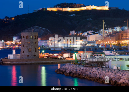 Marina entrance and Monte Hacho and fortress in background Ceuta . Spain. - Stock Photo
