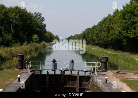 Burgundian canals - Canal du Centre. View of a lock - Stock Photo