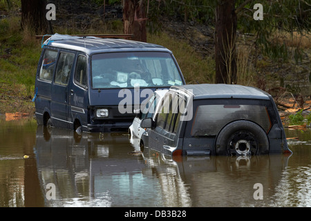 Flooded Castleton Street, Allanton, Taieri Plains, near Dunedin, South Island, New Zealand - Stock Photo