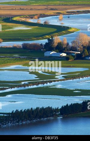 Taieri River and flooded farmland on Taieri Plains, near Mosgiel, Dunedin, South Island, New Zealand - Stock Photo