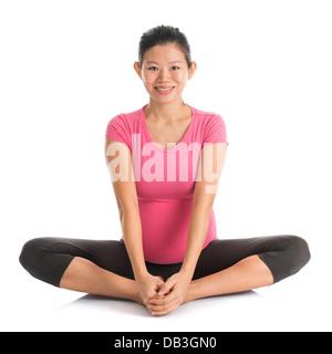 asian woman doing yoga pose easy pose sanskrit name