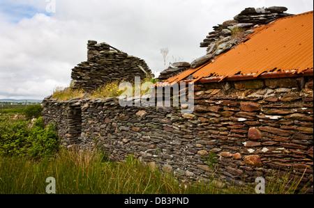 Vintage stone animal shelter farm or house ruins in the Irish countryside near Cahersiveen, Ireland, Europe, historic