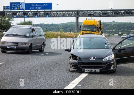 Motorway Accident High Speed Puncture. Collision with central reservation barrier. - Stock Photo