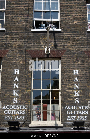 exterior of hank's guitar shop, specialising in acoustic guitars, denmark street, london, england - Stock Photo