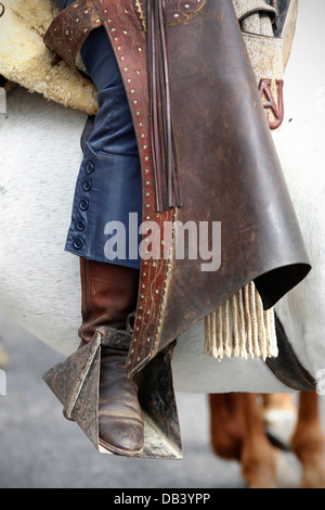 Male horse rider in Andalusia Spain wearing leather gaiters and boots - Stock Photo