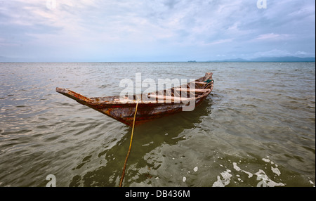 Empty old wooden boat on the waves close up - Stock Photo