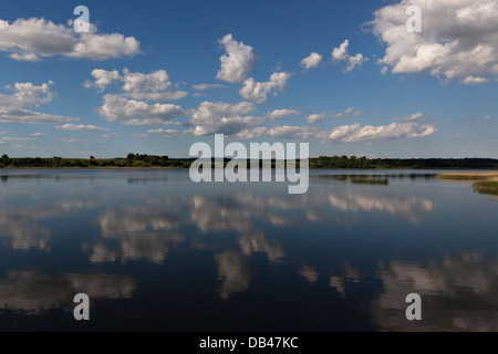 Clouds on a summerday mirrors on the water at Haraldsted Sø (Haraldsted Lake)near Ringsted in mid Zealand, Denmark - Stock Photo
