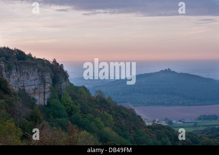 Beautiful scenic long-distance landscape from Sutton Bank over Hood Hill, Whitestone Cliff & countryside at sunrise - Stock Photo